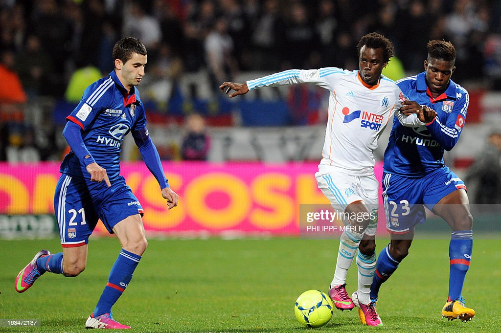 Lyon's French midfielder Maxime Gonalons (L) and Lyon's French defender Samuel Umtiti (R) vie with Marseille's Senegalese forward Modou Sougou during the French L1 football match Olympique Lyonnais (OL) vs Olympique de Marseille (OM) on March 10, 2013 at the Gerland stadium in Lyon, southeastern France.