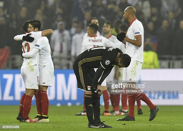 Lyon's French midfielder Maxime Gonalons reacts as Sevilla's players celebrate at the end of the UEFA Champions League Group H football match between...