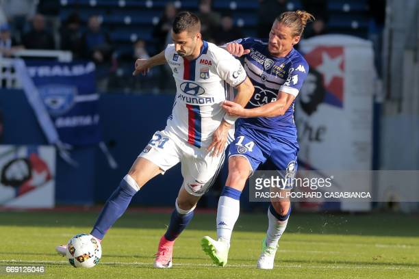 Lyon's French midfielder Maxime Gonalons vies with Bastia's Algerian midfielder Mehdi Mostefa during the French L1 Football match between Bastia and...