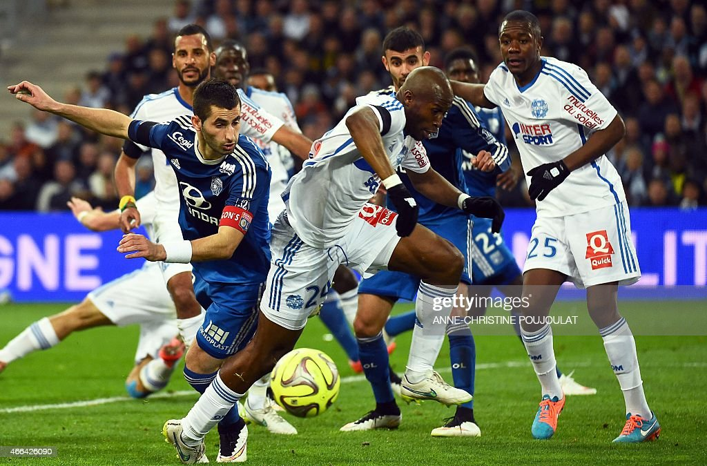 Lyon's French midfielder Maxime Gonalons vies with Marseille's French defender Rod Fanni during the French L1 football match between Marseille and...