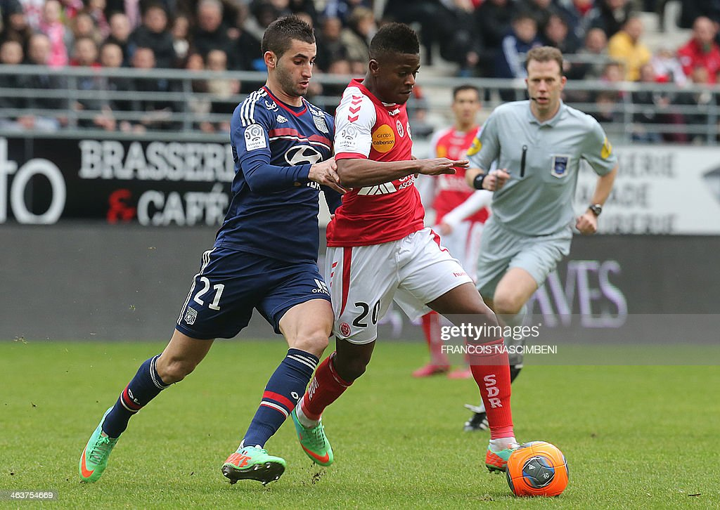 Lyon's French midfielder Maxime Gonalons (L) vies with Reims' forward Floyd Ayite during a French L1 Football match between Reims and Lyon on January 19, 2014 at the Auguste Delaune Stadium in Reims.