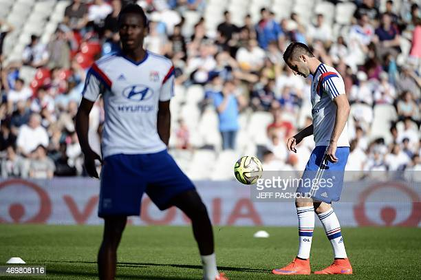 Lyon's French midfielder Maxime Gonalons warms up with his teammates prior to the French L1 football match Olympique Lyonnais vs SC Bastia on April...