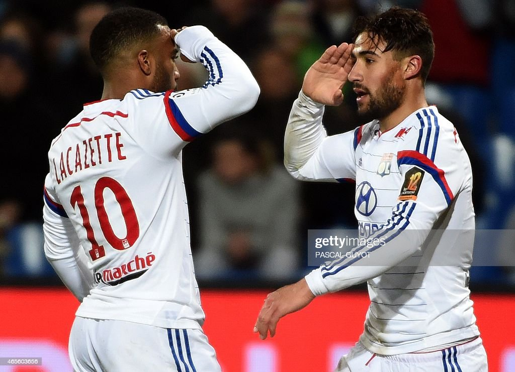 Lyon's French midfielder Nabil Fekir (R) and Lyon's French forward <a gi-track='captionPersonalityLinkClicked' href=/galleries/search?phrase=Alexandre+Lacazette&family=editorial&specificpeople=6927653 ng-click='$event.stopPropagation()'>Alexandre Lacazette</a> (L) react after scoring a goal during the French L1 football match between Montpellier and Lyon on March 8, 2015 at the La Mosson Stadium in Montpellier, southern France.
