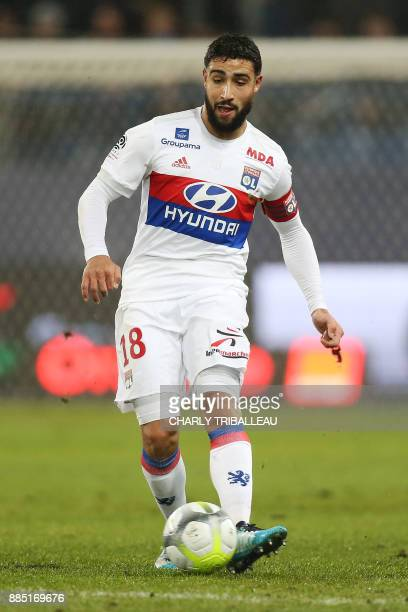 Lyon's French midfielder Nabil Fekir controls the ball during the French L1 football match between Caen and Lyon on December 3 at the Michel d'Ornano...