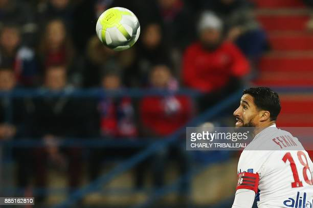 Lyon's French midfielder Nabil Fekir eyes the ball during the French L1 football match between Caen and Lyon on December 3 at the Michel d'Ornano...