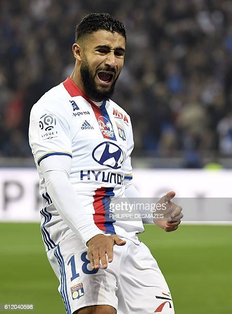 Lyon's French midfielder Nabil Fekir reacts after missing a goal opportunity during the French L1 football match between Lyon and AS SaintEtienne at...