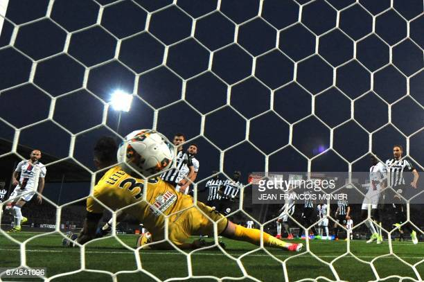 Lyon's French midfielder Nabil Fekir scores past Angers' French goalkeeper Alexandre Letellier during the French L1 football match between Angers and...