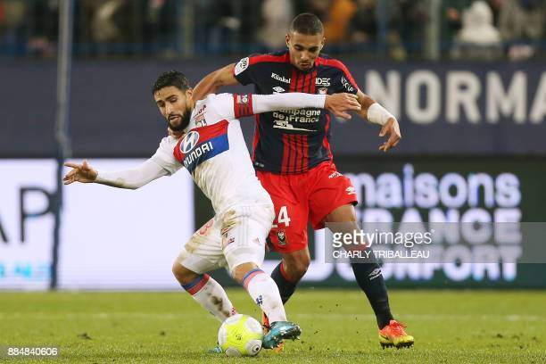 Lyon's French midfielder Nabil Fekir vies for the ball with Caen's French defender Alexander Djiku during the French L1 football match between Caen...