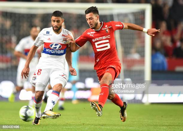 Lyon's French midfielder Nabil Fekir vies for the ball with Rennes' Algerian defender Rami Amir Selmane Bensebaini during the French L1 football...