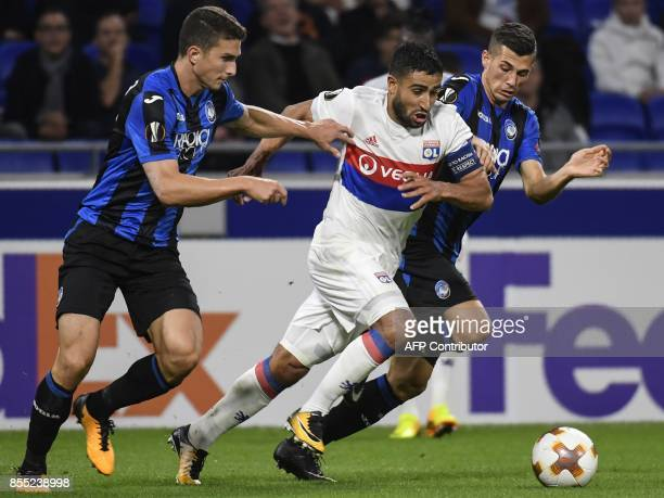 Lyon's French midfielder Nabil Fekir vies with Atalanta's Swiss midfielder Remo Freuler and Atalanta's Italian defender Mattia Caldara during the...