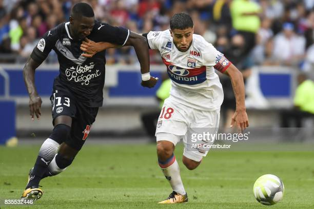 Lyon's French midfielder Nabil Fekir vies with Bordeaux's Senegalese midfielder Younousse Sankhare during the L1 football match Olympique Lyonnais vs...