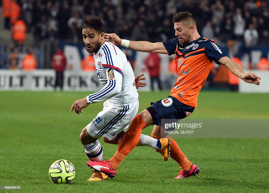 Lyon's French midfielder Nabil Fekir (L) vies with Montpellier's French forward Anthony Mounier (R) during the French L1 football match between Montpellier and Lyon, on March 8, 2015 at the La Mosson Stadium in Montpellier, southern France.