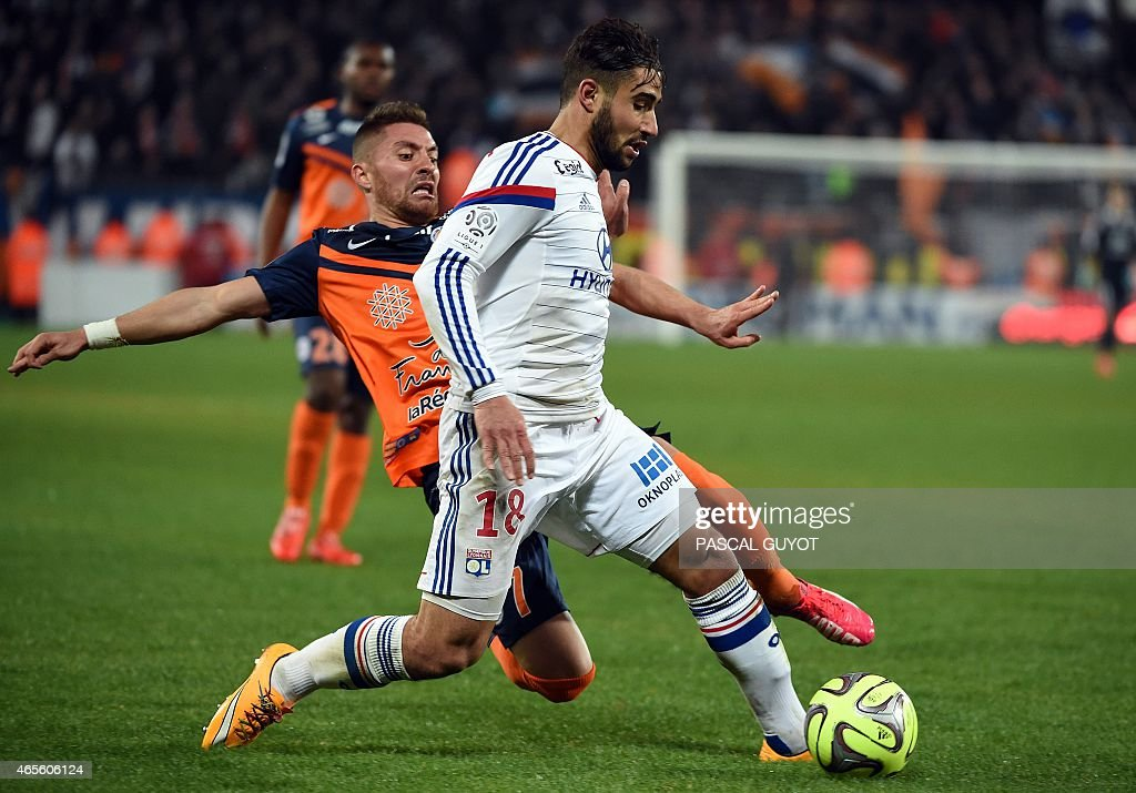 Lyon's French midfielder Nabil Fekir (R) vies with Montpellier's French forward Anthony Mounier (L) during the French L1 football match between Montpellier and Lyon, on March 8, 2015 at the La Mosson Stadium in Montpellier, southern France.
