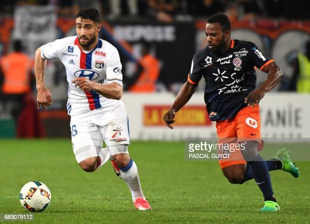 Lyon's French midfielder Nabil Fekir vies with Montpellier's French midfielder Stephane Sessegnon during the French L1 football match between...