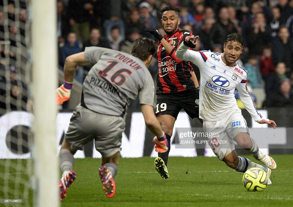 Lyon's French midfielder Nabil Fekir (R) vies with Nice's French goalkeeper <a gi-track='captionPersonalityLinkClicked' href=/galleries/search?phrase=Simon+Pouplin&family=editorial&specificpeople=2087398 ng-click='$event.stopPropagation()'>Simon Pouplin</a> (L) and Lyon's French defender Jordan Amavi (C) during the French L1 football match between Lyon and Nice on March 21, 2015, at the Gerland stadium in Lyon, central eastern France.