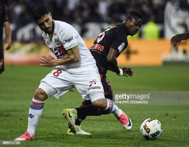 Lyon's French midfielder Nabil Fekir vies with Nice's Ivorian midfielder Jean Michael Seri during the French L1 football match between Lyon and Nice...