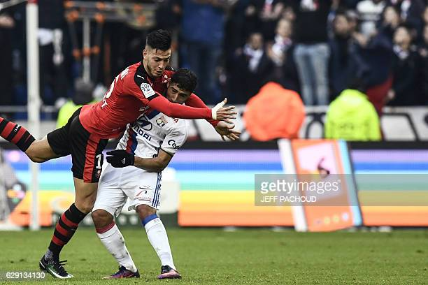 Lyon's French midfielder Nabil Fekir vies with Rennes'Algeria defender Ramy Bensebaini during the French L1 football match Olympique Lyonnais vs...