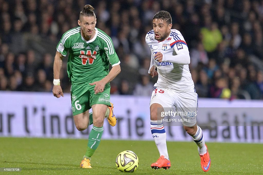 Lyon's French midfielder <a gi-track='captionPersonalityLinkClicked' href=/galleries/search?phrase=Nabil+Fekir&family=editorial&specificpeople=11185925 ng-click='$event.stopPropagation()'>Nabil Fekir</a> (R) vies with Saint-Etienne's French midfielder Jeremy Clement during the French L1 football match between Lyon and Saint-Etienne on April 19, 2015 at the Gerland stadium in Lyon.