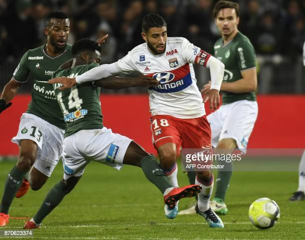 Lyon's French midfielder Nabil Fekir vies with SaintEtienne's French forward Jonathan Bamba during the French L1 football match between AS...