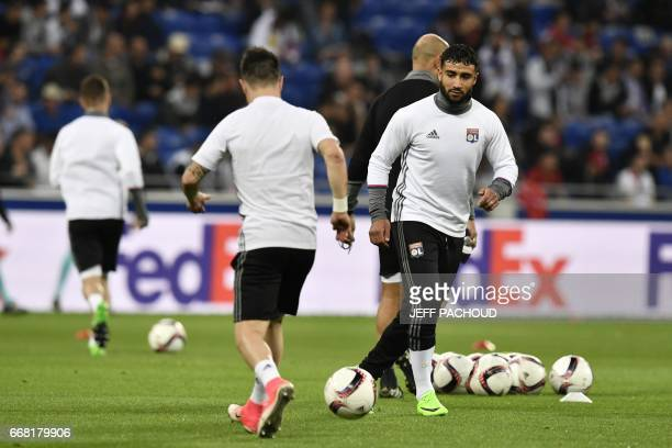 Lyon's French midfielder Nabil Fekir warms up prior to the UEFA Europa League first leg quarter final football match between Lyon and Besiktas on...