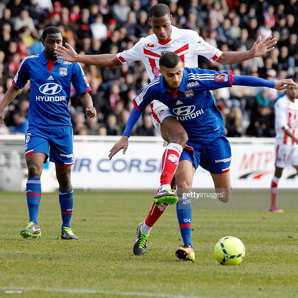 Lyon's French midfielder Rachid Ghezzal vies with Ajaccio's French midfielder Ricardo Faty during the French L1 football match Ajaccio (ACA) vs Lyon (OL) at the Francois Coty stadium in Ajaccio, on February 3, 2013.