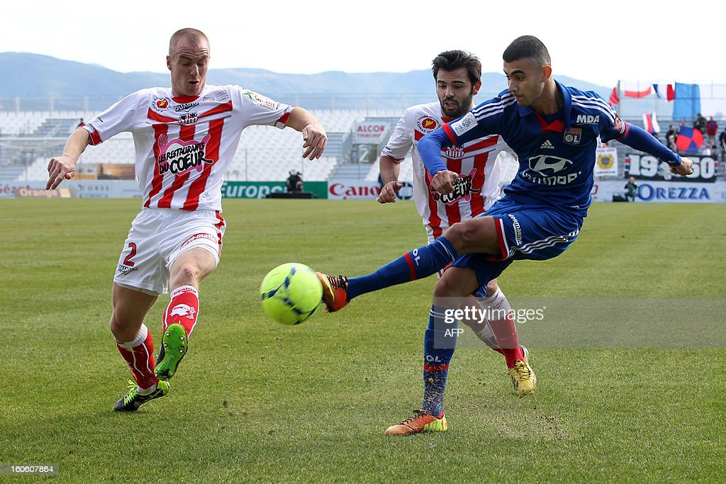 Lyon's French midfielder Rachid Ghezzal (R) vies with Ajaccio's French defender Matthieu Chalme during the French L1 football match Ajaccio (ACA) vs Lyon (OL) in the Francois Coty stadium in Ajaccio, French mediterranean island of Corsica, on February 3, 2013.