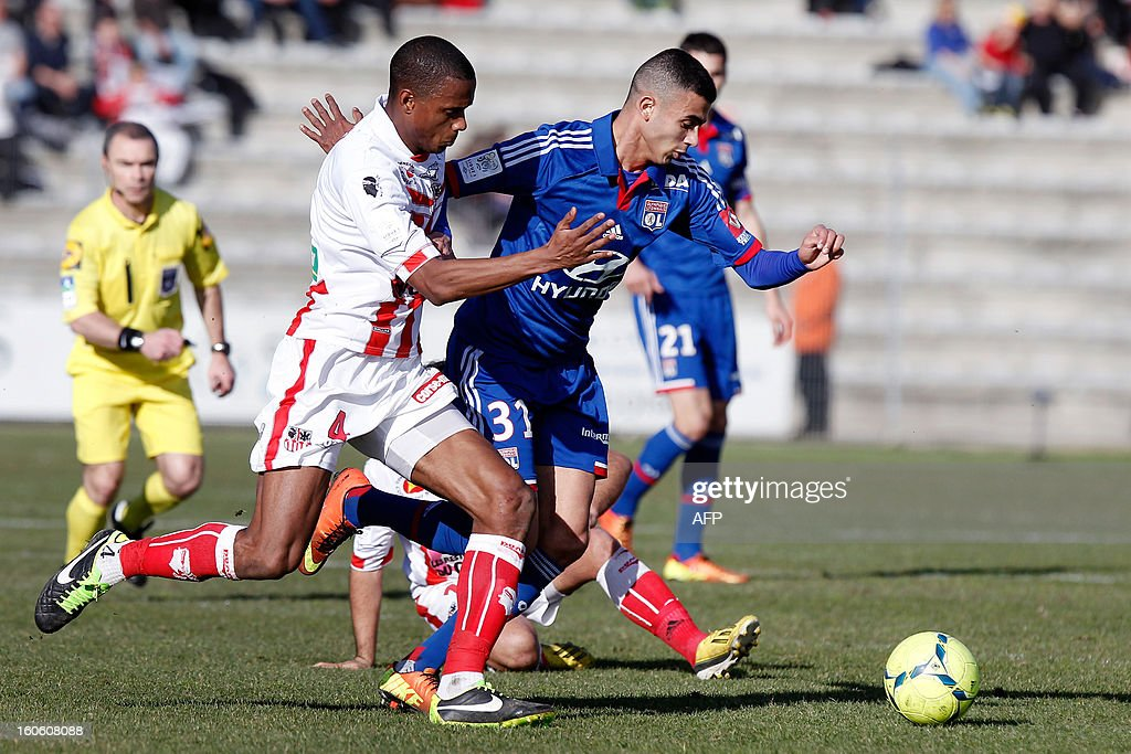 Lyon's French midfielder Rachid Ghezzal (R) vies with Ajaccio's French midfielder Ricardo Faty (L) during the French L1 football match Ajaccio (ACA) vs Lyon (OL) in the Francois Coty stadium in Ajaccio, French Mediterranean island of Corsica, on February 3, 2013.