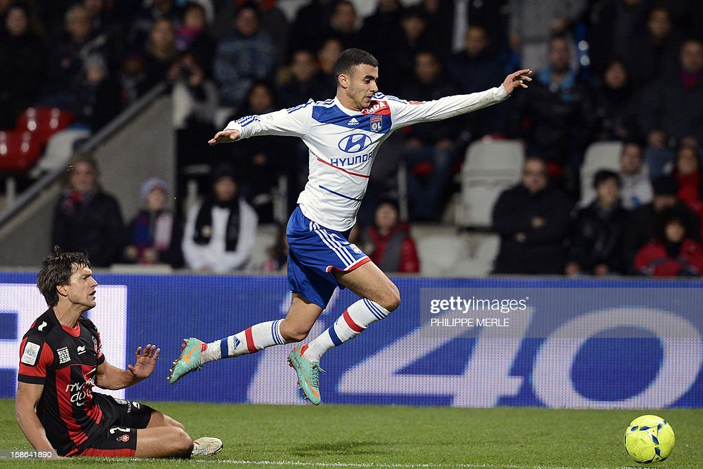 Lyon's French midfielder Rachid Ghezzal (L) vies with Nice's Argentinian defender Renato Civelli during the French L1 football match Lyon vs Nice, on December 22, 2012 at the Gerland stadium in Lyon, central eastern France.