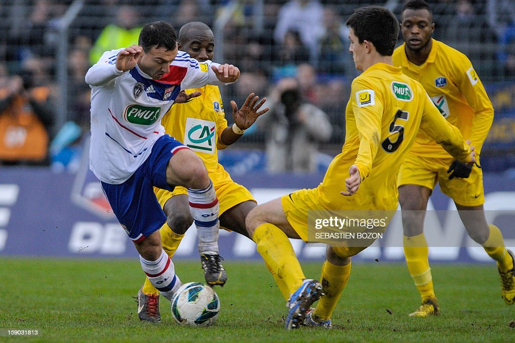 Lyon's French midfielder Steed Malbranque (L) vies with Epinal's French defender Wilfried Rother (R) during a French Cup football match between Epinal (SAS) and Lyon (OL) at the Colombiere Stadium in Epinal on January 6, 2013.