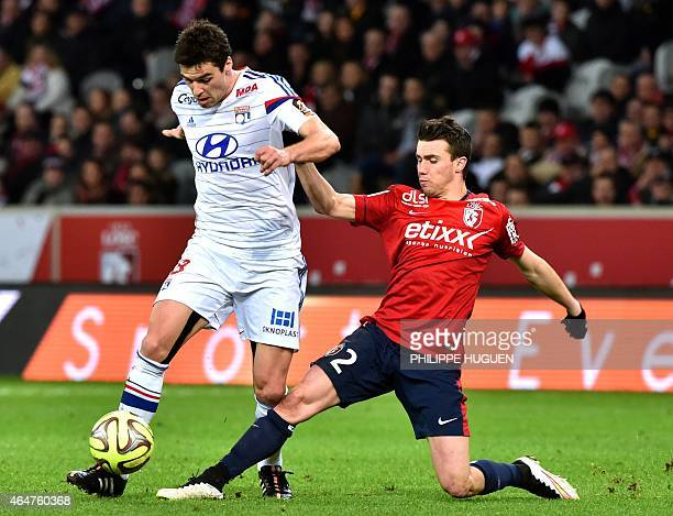 Lyon's French midfielder Yoann Gourcuff vies for the ball with Lille's French defender Sebastien Corchia during the French L1 football match between...