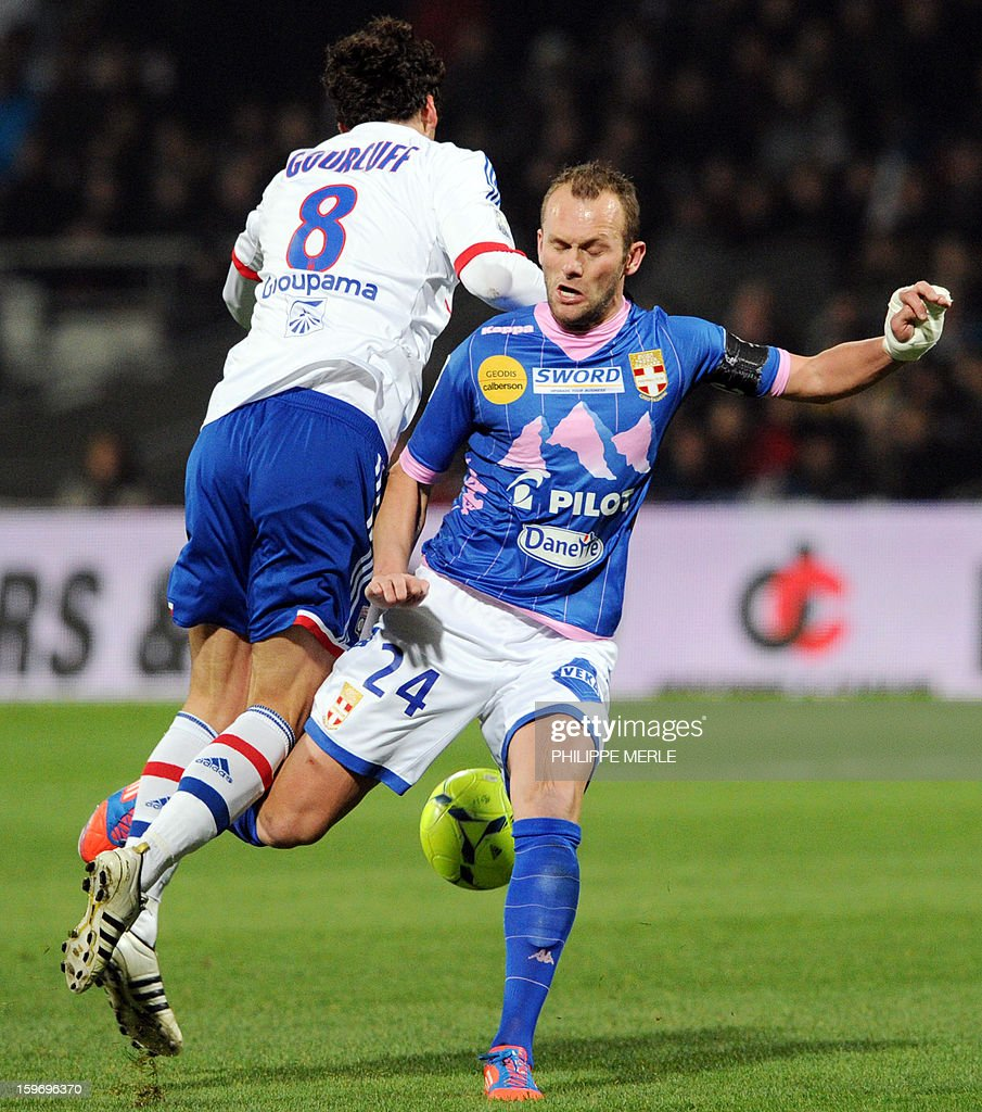 Lyon's French midfielder Yoann Gourcuff (L) vies with Evian's French midfielder Olivier Sorlin during the French L1 football match Lyon (OL) vs Evian (TG) on January 18, 2013 at the Gerland stadium in Lyon.