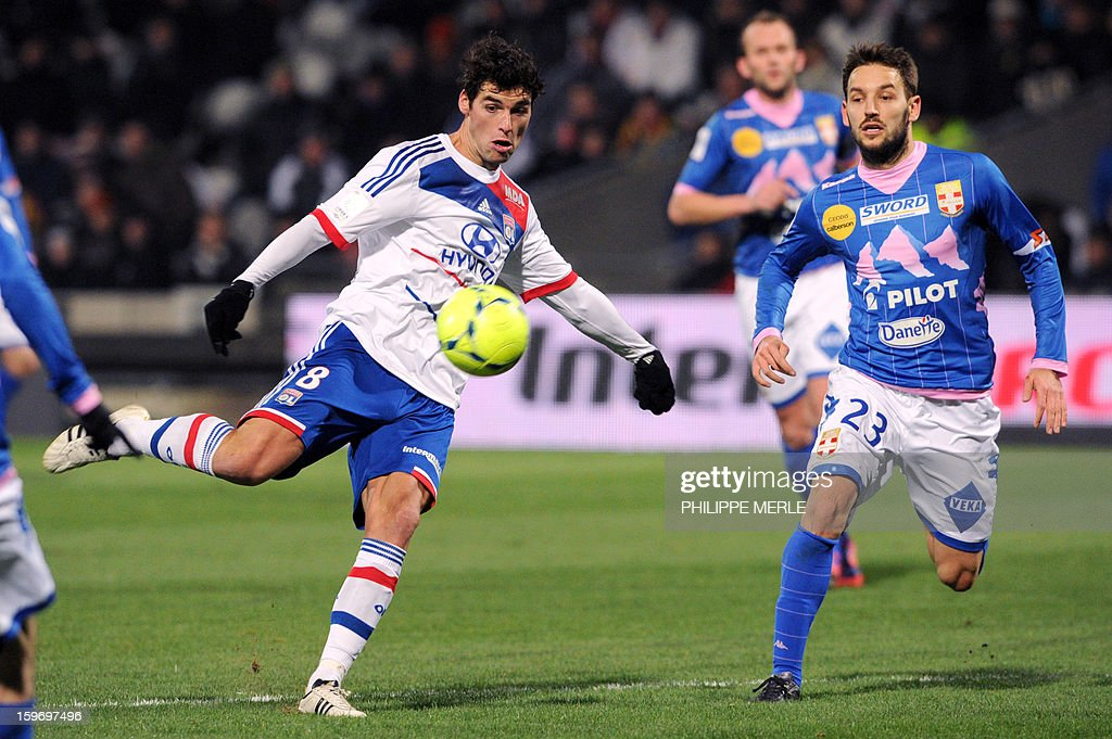Lyon's French midfielder Yoann Gourcuff (L) vies with Evian's Serbian midfielder Milos Ninkovic during the French L1 football match Lyon (OL) vs Evian (ETG FC) on January 18, 2013 at the Gerland stadium in Lyon.