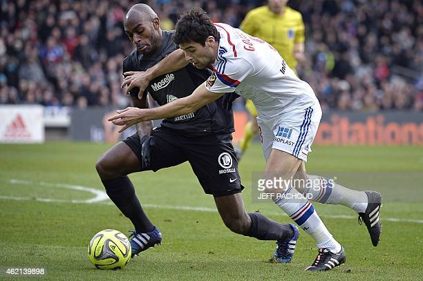 Lyon's French midfielder Yoann Gourcuff vies with Metz's French defender Jonathan Rivierez during the French L1 football match Lyon vs Metz on...