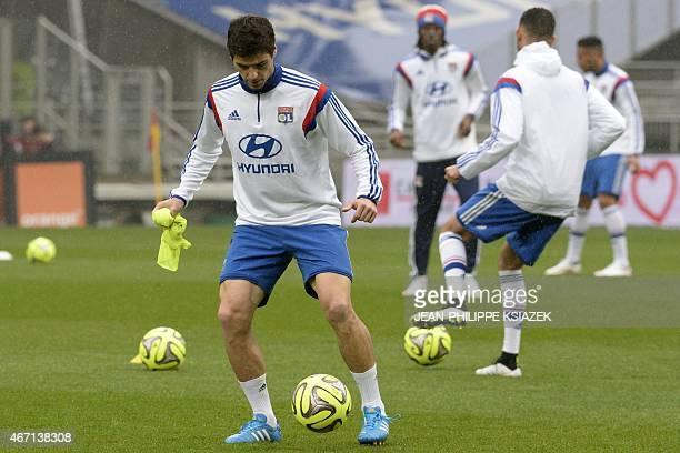 Lyon's French midfielder Yoann Gourcuff warms up prior with teammates prior to the French L1 football match between Lyon and Nice on March 21 at the...
