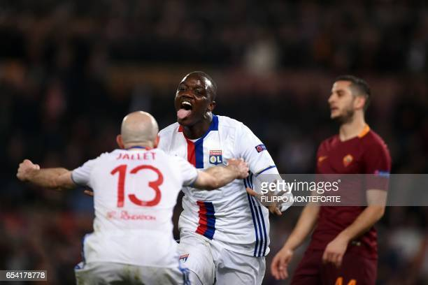 TOPSHOT Lyon's French Mouctar Diakhaby celebrates with a teammate after scoring a goal during the Europa League Round of 16 return football match...