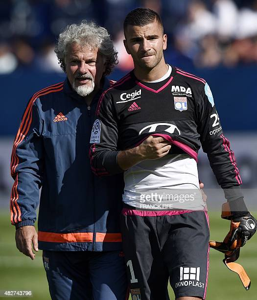 Lyon's French Portuguese goalkeeper Anthony Lopes and Lyon's French gaolkeeper coach Joel Bats react at the end of the French Trophy of Champions...