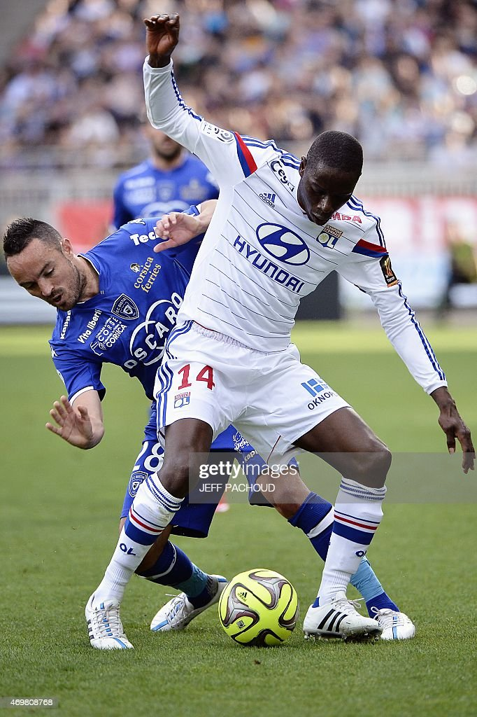 Lyon's French Senegalese defender Mouhamadou Dabo (R) vies with Bastia's French midfielder <a gi-track='captionPersonalityLinkClicked' href=/galleries/search?phrase=Gael+Danic&family=editorial&specificpeople=650403 ng-click='$event.stopPropagation()'>Gael Danic</a> during the French L1 football match Olympique Lyonnais (OL) vs SC Bastia (SCB) on April 15, 2015, at the Gerland Stadium in Lyon, central-eastern France.