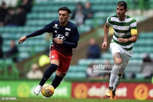 Lyon's French striker Amine Gouiri runs with the ball during the preseason friendly football match between Glasgow Celtic and Olympique Lyonnais at...