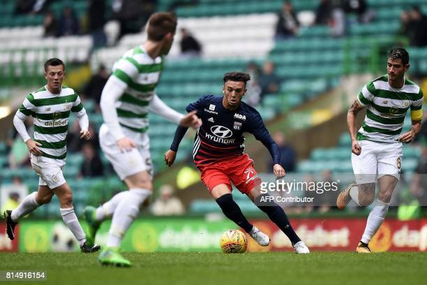 Lyon's French striker Amine Gouiri runs with the ball during the preseason friendly football match between Glasgow Celtic and Olympique Lyonnais at...