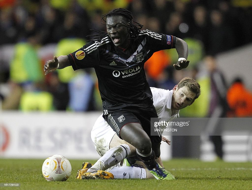 Lyon's French striker Bafetibis Gomis (L) is tackled by Tottenham Hotspur's Belgian defender Jan Vertonghen during the Europa League Round of 32 football match between Tottenham Hotspur and Lyon at White Hart Lane in London, England, on February 14, 2013. Tottenham Hotspur won 2-1.