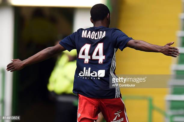 Lyon's French striker Myziane Maolida celebrates after scoring a goal during the preseason friendly football match between Glasgow Celtic and...