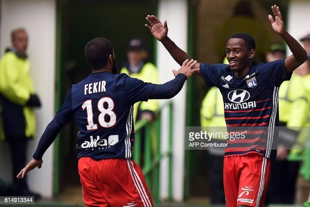 Lyon's French striker Myziane Maolida celebrates with Lyon's French midfielder Nabil Fekir after scoring a goal during the preseason friendly...