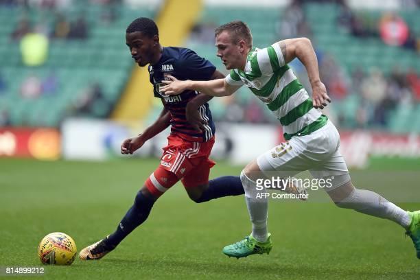 Lyon's French striker Myziane Maolida vies with Celtic's Scottish midfielder Mark Hill during the preseason friendly football match between Glasgow...