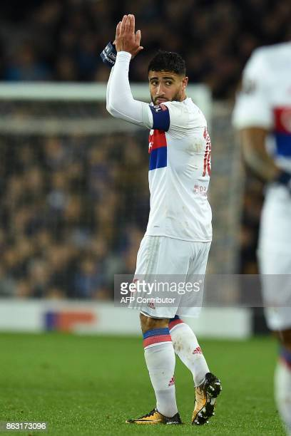 Lyon's French striker Nabil Fekir applauds supporters as he leaves the field substituted during the UEFA Europa League Group E match between Everton...