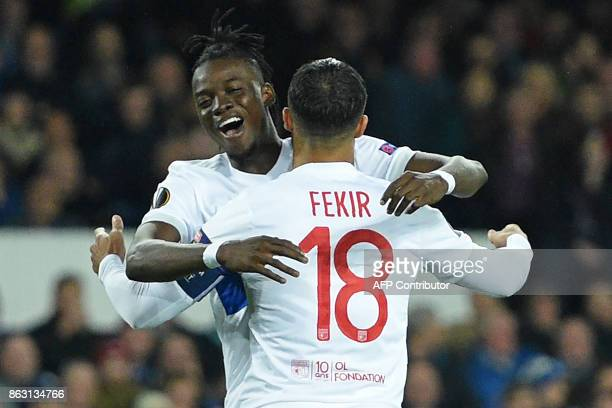Lyon's French striker Nabil Fekir celebrates with Lyon's Burkinabe striker Bertrand Traore after scoring the opening goal from the penalty spot...