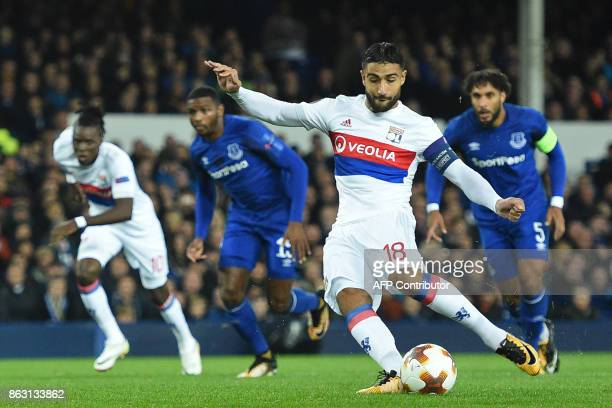 Lyon's French striker Nabil Fekir scores the opening goal from the penalty spot during the UEFA Europa League Group E match between Everton and Lyon...