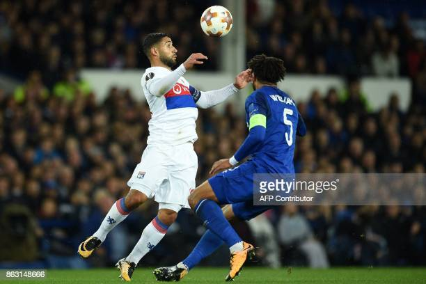 Lyon's French striker Nabil Fekir vies with Everton's Englishborn Welsh defender Ashley Williams during the UEFA Europa League Group E match between...