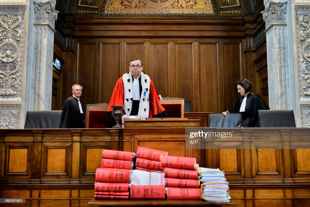 Lyon's General Prosecutor Jacques Beaume (C) enters Lyon's criminal courtroom, on April 2, 2013, on the opening day of Christophe Khider and Omar Top El Hadj's trial. They are judged for having escaped from jail using explosives and taking hostages two prison staffs.