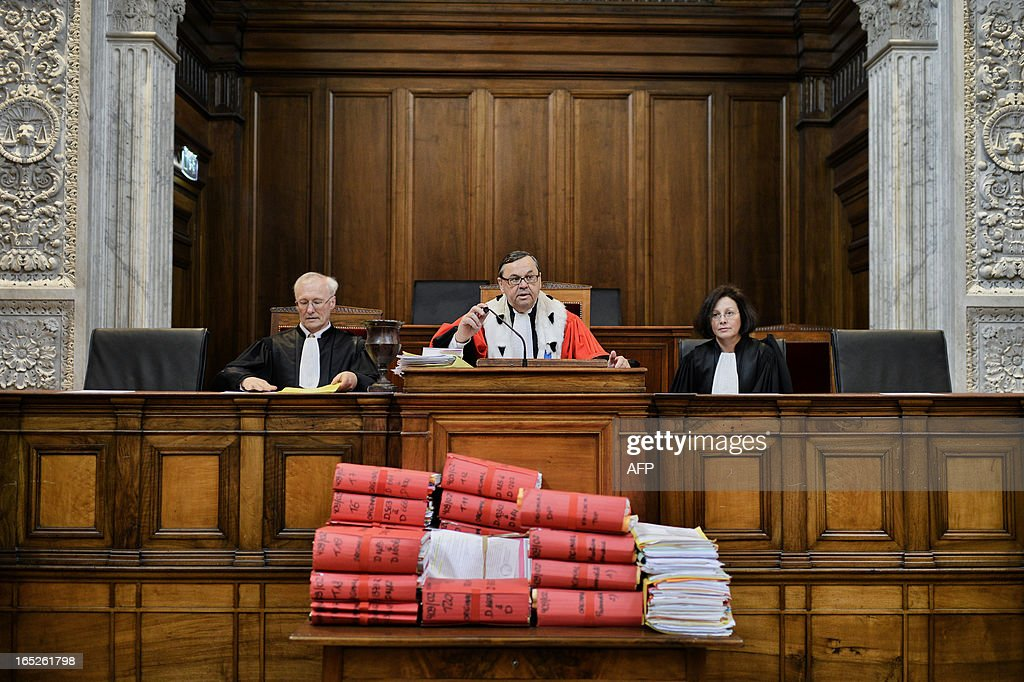 Lyon's General Prosecutor Jacques Beaume (C) sits in Lyon's criminal courtroom, on April 2, 2013, on the opening day of Christophe Khider and Omar Top El Hadj's trial. They are judged for having escaped from jail using explosives and taking hostages two prison staffs.