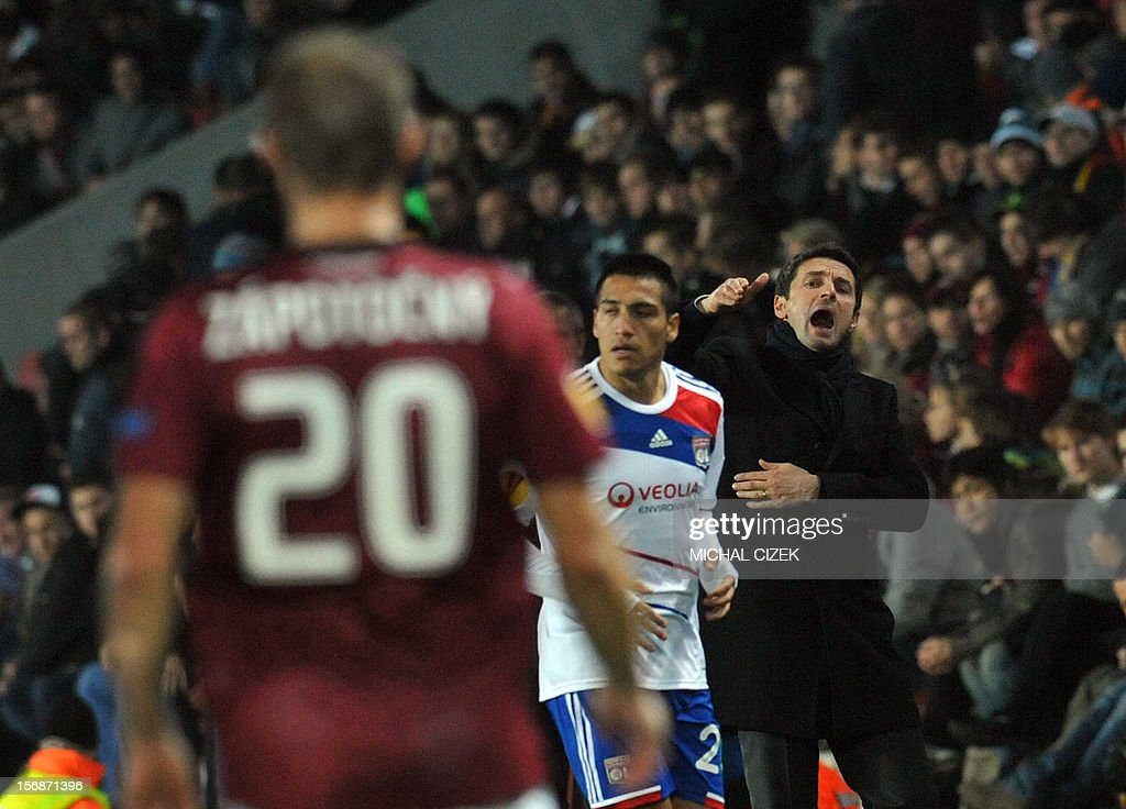 Lyon's head coach Remi Garde (R) (R) reacts during the UEFA Europa League Group I football match Sparta Praha vs Lyon in Prague, Czech Republic on November 22, 2012. The match ended 1-1.